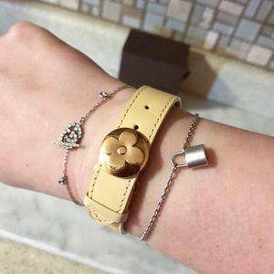Auth. Louis Vuitton Cream Leather Flower Bracelet